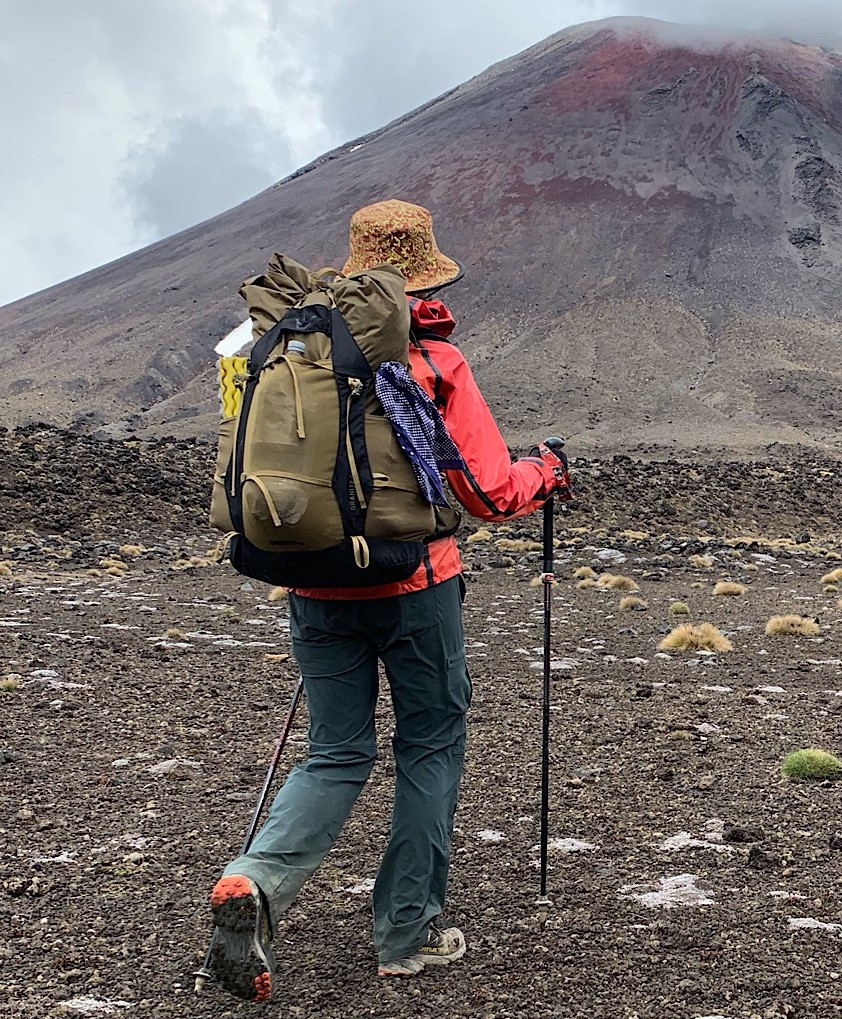 Tramper with pack at Tongariro National Park